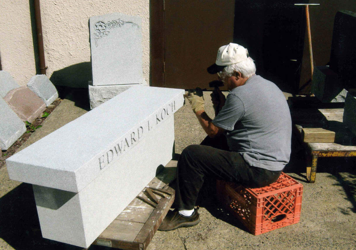 Charles Minozzi Sr at work engraving
